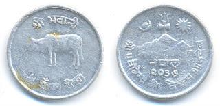 Una de las monedas del cubo (algo más limpia)